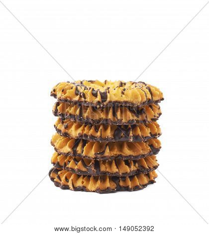 Stack of round cookies with the pieces of chocolate isolated over the white background