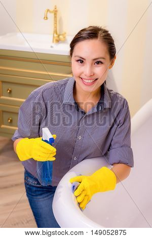 Young beautiful asian woman housekeeping in the bathroom