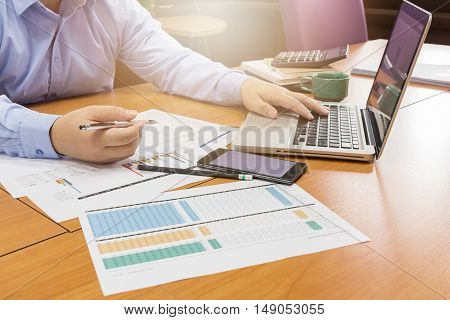 Business man working with smartphone and paperwork