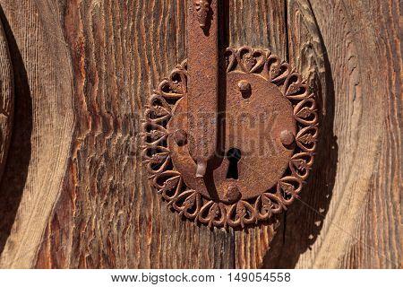 Rusty door keyhole background with golden tones