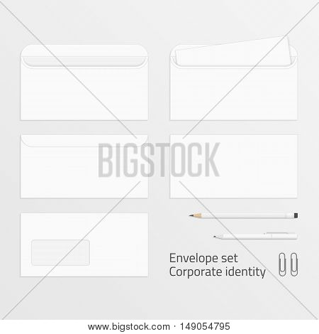 Blank envelopes set. Photo-realistic vector templates of corporate identity. Branding design. Letterhead, open and close envelopes, pencils, pen and paper clip. Blank mockup for design.