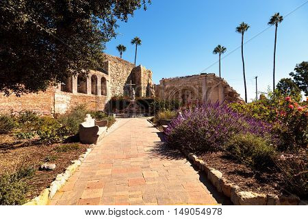San Juan Capistrano, CA, USA --September 25, 2016: Statue of  Fray Junipero Serra at the Mission San Juan Capistrano in Southern California, United States. Editorial use only.