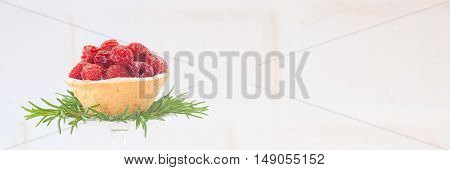 Raspberry Tartlet With Rosemary Decoration On White Background. High Key Image. Holiday Season Desse