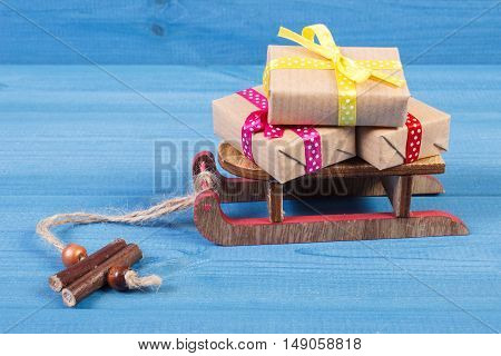 Wooden Sled And Wrapped Gifts For Christmas Or Other Celebration
