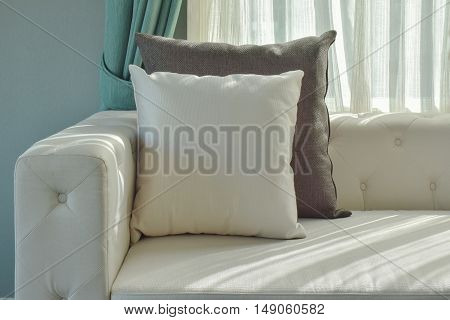 Black And White Pillow On Beige Sofa With Natural Light In The Living Room