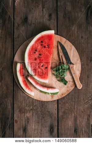 Fresh watermelon slices on the wood cutting board