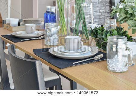 elegant table set in modern style dining room interior