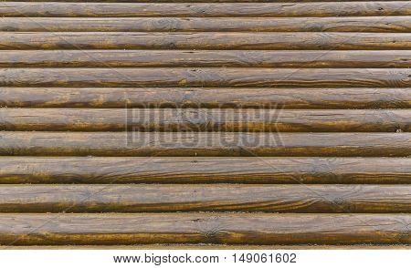 Wall of wooden logs wood industry background