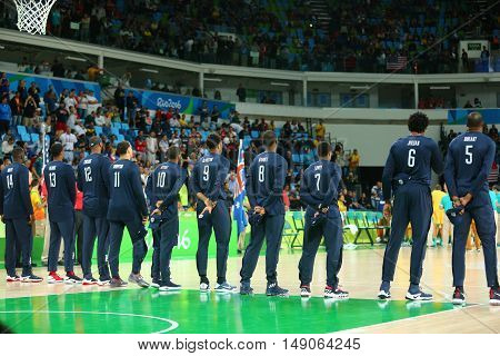 RIO DE JANEIRO, BRAZIL - AUGUST 10, 2016: Team United States during National Anthem before group A basketball match between Team USA and Australia of the Rio 2016 Olympic Games at Carioca Arena 1