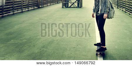 Young Girl Skateboard Outdoors Urban Concept