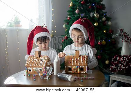 Two Sweet Boys, Brothers, Making Gingerbread Cookies House, Decorating At Home In Front Of The Chris