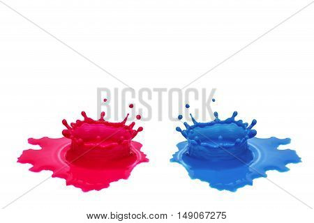 Red and blue color water splash against each other on a isolated white surface