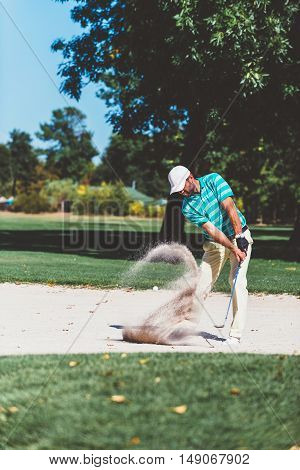 Golfer in sand trap, toned image, vertical image, green