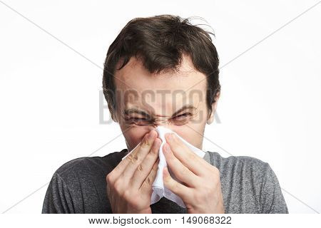 Close Up Of Man Blowing Nose
