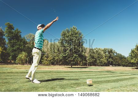 Golfer checking the wind, toned image, horizontal image, green