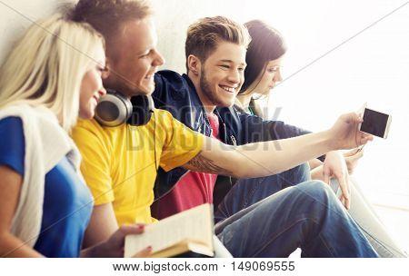 Group of hipsters taking selfie. Happy teenage students on a break at school.