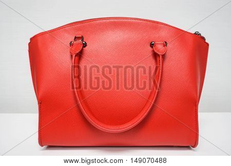 isolated light red woman bag on table