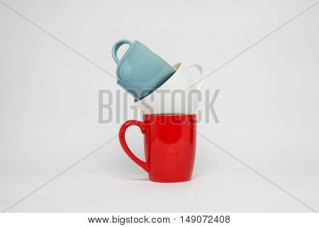 Color cups on a white a background