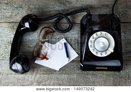 Old Glasses And Vintage Black Phone