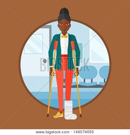 An african injured woman with leg in plaster. Woman with broken using crutches. Woman with fractured leg in the hospital corridor. Vector flat design illustration in the circle isolated on background.