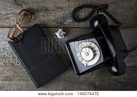 Vintage Black Phone, Old Glasses And Notebook