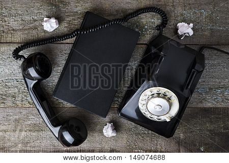 Vintage Black Phone And Notebook