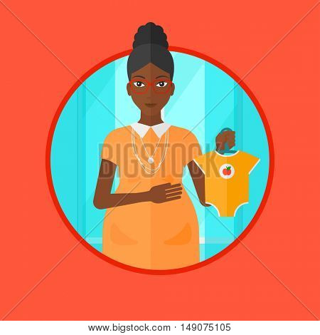 An african-american pregnant woman holding clothes for her baby. Young pregnant woman with presents at baby shower. Vector flat design illustration in the circle isolated on background.