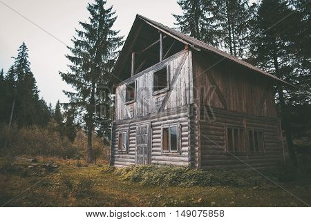 Big old wooden house in the forest in the evening