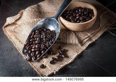 Coffee bean on black stone background. Selective focus