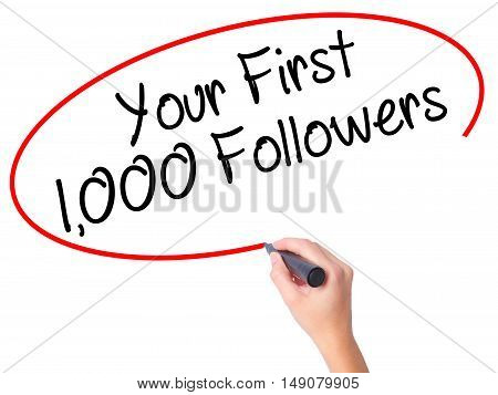 Women Hand Writing Your First 1,000 Followers  With Black Marker On Visual Screen