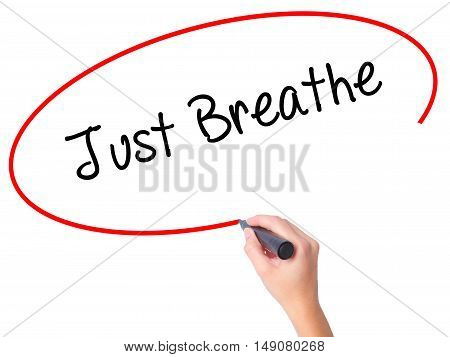 Women Hand Writing Just Breathe With Black Marker On Visual Screen