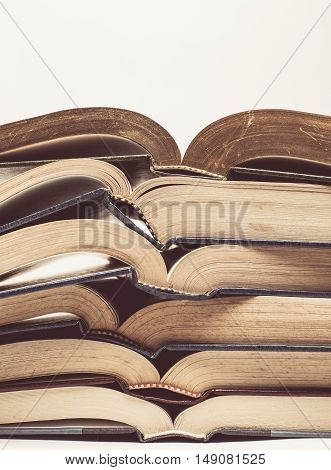 Vintage tone of Composition with stack of book on white background