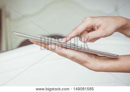 Woman hand on tablet pc access for knowledge