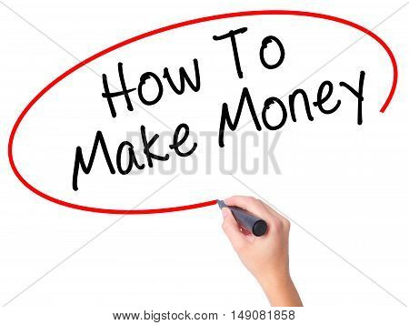 Women Hand Writing How To Make Money With Black Marker On Visual Screen