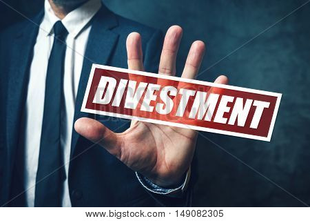 Divestment concept with businessman in suite - finance and economics business theme.
