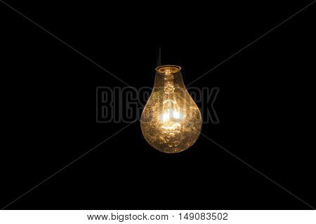 hanging of dim incandescent lamp in dark space
