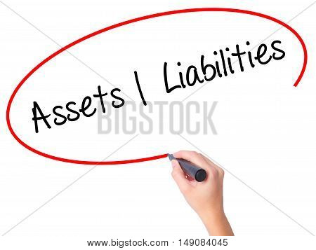 Women Hand Writing Assets Liabilities With Black Marker On Visual Screen