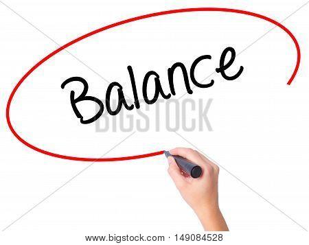 Women Hand Writing Balance With Black Marker On Visual Screen