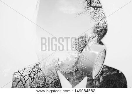 Double exposure, businessman wearing toxic protection mask with dead trees environment, concept of pollution and global warming effects from industry business