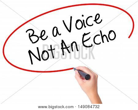 Women Hand Writing Be A Voice Not An Echo With Black Marker On Visual Screen