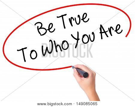 Women Hand Writing Be True To Who You Are With Black Marker On Visual Screen