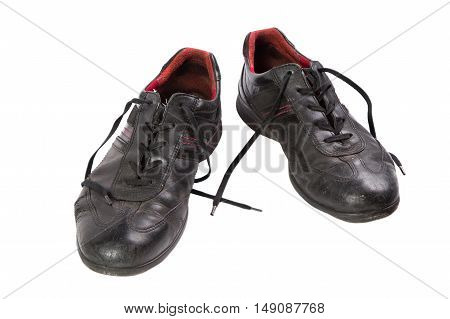 worn black men's shoes isolated a white background