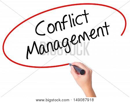 Women Hand Writing Conflict Management With Black Marker On Visual Screen.