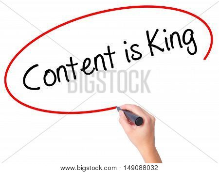 Women Hand Writing Content Is King With Black Marker On Visual Screen