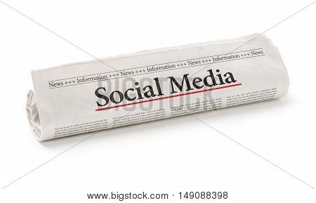 Rolled Newspaper With The Headline Social Media