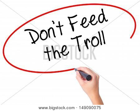 Women Hand Writing Don't Feed The Troll With Black Marker On Visual Screen.