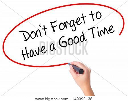 Women Hand Writing Don't Forget To Have A Good Time With Black Marker On Visual Screen