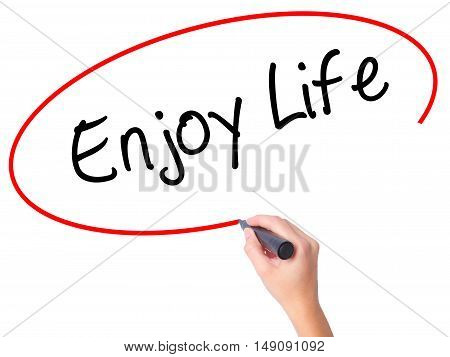 Women Hand Writing Enjoy Life With Black Marker On Visual Screen