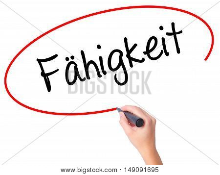 Women Hand Writing Fahigkeit (ability In German) With Black Marker On Visual Screen
