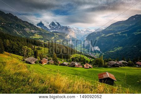 Majestic view of alpine village. Picturesque and gorgeous scene. Famous tourist attraction. Location place Swiss alps, Lauterbrunnen valley, Wengen, Bernese Oberland, Europe. Beauty world.